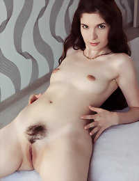 Naked girl playing on bed